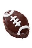 Football shaped brownie. Homemade brownies in the shape of a football and decorated with dark chocolate icing and white piping. Isolated on white background Royalty Free Stock Photos