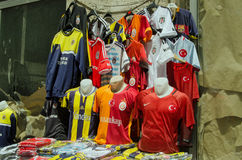Football Shirts in Istanbul Bazaar. ISTANBUL, TURKEY - JUNE 8, 2016:  Replica football team shirts for sale on a market stall on the street in Istanbul.  The Stock Photo