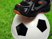 Football shoe and soccer ball royalty free stock photography