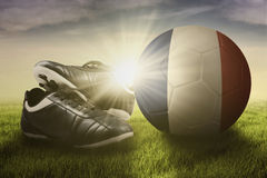 Football shoes with ball and flag of France Stock Photo