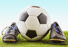 Football with shoes Stock Photo