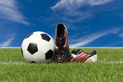 Football shoes and a football Royalty Free Stock Photo