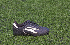 Football shoes on the grass. Picture wallpaper sport  art  background Royalty Free Stock Images
