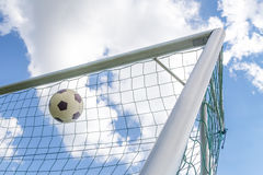 Football shot in corner of goal Royalty Free Stock Photo
