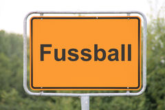 A football sign. A yellow football sign in Germany at the street Royalty Free Stock Photography