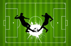Football or soccer background. With silhouettes of players Stock Photos