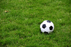 Football or soccer ball. A standard leather football or soccer ball on the pitch Stock Photography