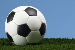 Football - Soccer ball against blue sky Stock Photos