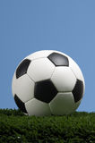 Football - Soccer ball against blue sky Royalty Free Stock Photo