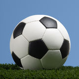 Football - Soccer ball against blue sky Stock Photography