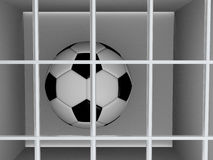 Football or soccer ball behind the bars Royalty Free Stock Photography