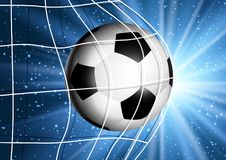 Football or soccer ball flying into the goal. Net Royalty Free Stock Photography
