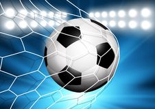 Football or soccer ball flying into the goal. Net Royalty Free Stock Photo