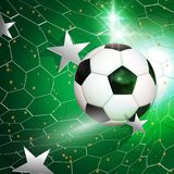 Football  soccer ball flying into the goal net with silver stars Stock Photography