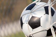 Football, soccer ball in goal net Royalty Free Stock Image