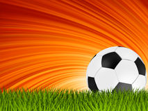 Football or soccer ball on grass. EPS 8. Football or soccer ball on grass with a starburst backgrond. EPS 8  file included Stock Photo