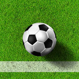 Football ( soccer  ball ) in grass field. Royalty Free Stock Photo