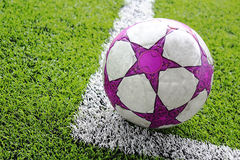 Football or soccer ball on the grass field Stock Photos