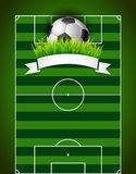 Football soccer ball on green field background. Football soccer ball with green grass,white ribbon on green field background presentation Royalty Free Stock Images
