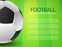Football (soccer) ball on green field background Royalty Free Stock Images
