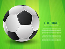 Football (soccer) ball on green field background Royalty Free Stock Photography