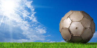 Football - Soccer Ball with Green Grass Stock Photography