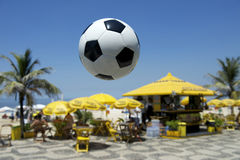 Football Soccer Ball Ipanema Beach Rio Brazil. Football soccer ball flying in front of boardwalk kiosk in Ipanema Beach Rio de Janeiro Brazil stock images