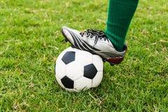 Football or soccer ball. At the kickoff of a game Stock Photo