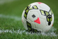 Football or soccer ball. Official football or soccer ball on green, grassy pitch Stock Photography