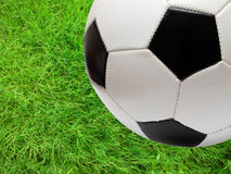 Football soccer ball over green grass royalty free stock image
