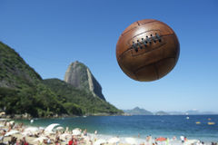 Football Soccer Ball Sugarloaf Mountain Rio de Janeiro Brazil. Football soccer ball flying above Rio de Janeiro beach at the foot of Pao de Acucar Sugarloaf royalty free stock photo