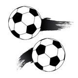 Football or soccer balls with motion trails. Stock Image