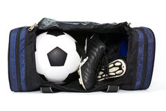 Football and soccer boots in sport bag Stock Photography