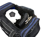 Football and soccer boots in sport bag. Football and soccer shoe in open a sport bag on white background Stock Image