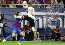 Football or soccer brutality. Astra's Junior Morais hit Steaua's Cornel Rapa in the head during the Romanian SuperCup final. Astra won the trophy after the Stock Images