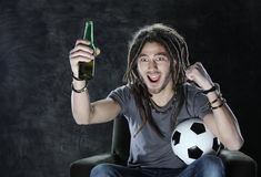 Football or soccer fan watching television Stock Photos