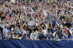 Football Soccer Fans. Cardiff City FC fans shouts with joy as they watch live telecast of the 136th FA Cup Final between Cardiff City and Portsmouth on a big royalty free stock photos