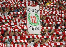 Football or soccer fans with red & white scarves Stock Photos