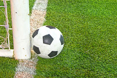 Football in soccer field. Football in soccer green field Royalty Free Stock Photography