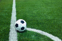 Football in soccer field Royalty Free Stock Image
