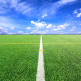 Football or Soccer field and bule sky Royalty Free Stock Photos