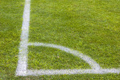 Football soccer field corner with white marks, green grass texture. Stock Photography