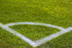 Football soccer field corner with white marks, green grass texture. Royalty Free Stock Image