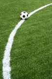 Football on soccer field with curve line Royalty Free Stock Images