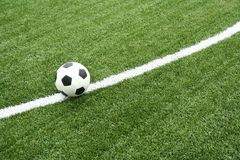 Football on soccer field with curve line Stock Image