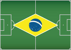 Football / soccer field with flag of Brazil. Vecto Stock Image