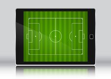 Football / soccer field on an electronic device tablet. Football / soccer field on a generic electronic device tablet Stock Photo