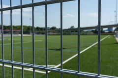 Football soccer field viewed through gate Stock Image