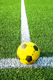 Football on soccer field Stock Image