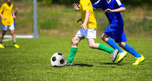 Football soccer game. Players footballers running and playing fo Royalty Free Stock Images